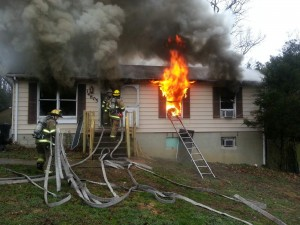 Fire Fighters Putting Out A Local House Fire