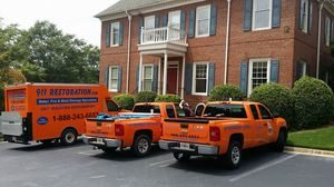 911 Restoration Fleet At A Residential Job Site